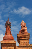 red statue in front of pagoda in Bagan(Pagan) poster