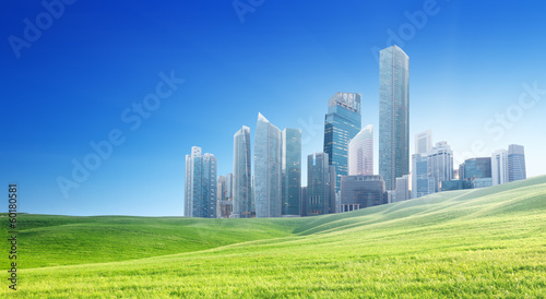 spring field and modern city