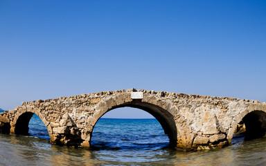 Ruined bridge in the sea. Zakynthos. Greece