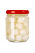 Isolated jar of pickled onions