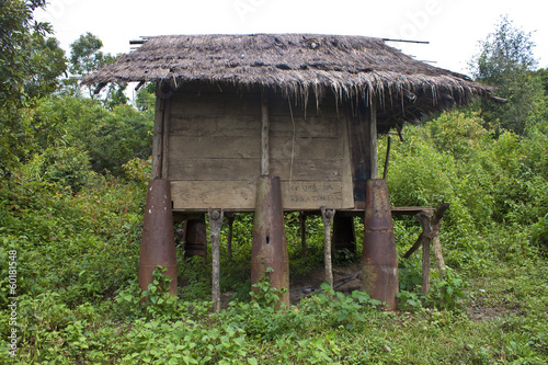 Hut built with war scrap, Laos