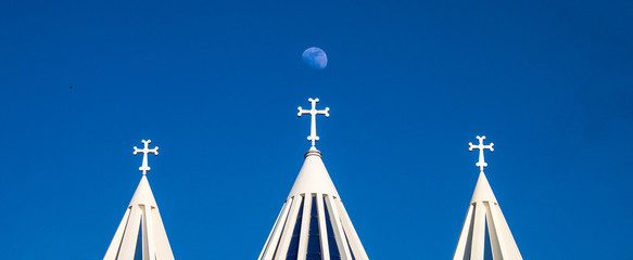 Moon and towers of Sarkis cathedral in Tehran, Iran