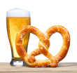 canvas print picture - Beer Glass with German Pretzel on wooden table. isolated