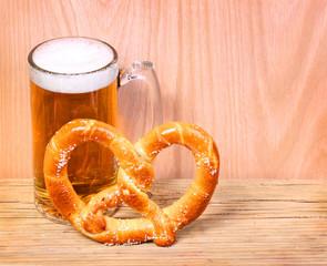 Beer Mug with German Pretzel on wooden background
