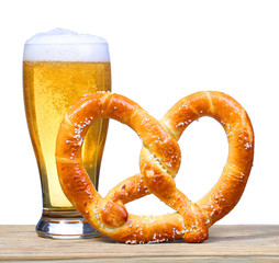 Beer Glass with German Pretzel on wooden table. isolated