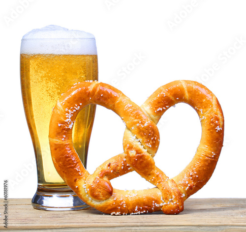 canvas print picture Beer Glass with German Pretzel on wooden table. isolated