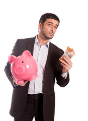 business man holding piggy bank with Australian dollars