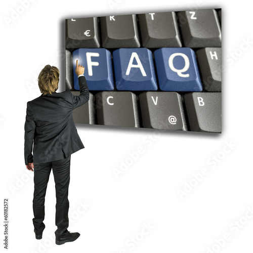 Businessman activating a FAQ key