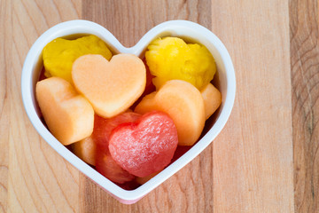Valentines Day healthy treat with heart-shaped fruit