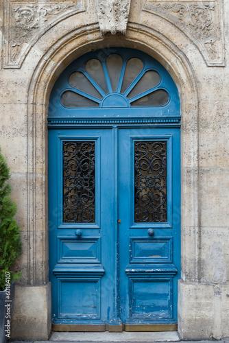 Fototapeta Blue Door in Paris with ornate decoration