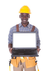 Young Repairman With Laptop