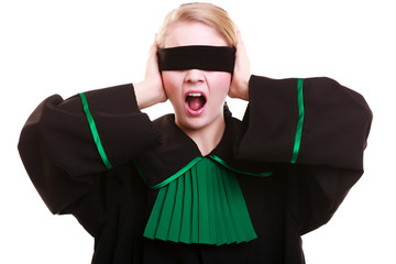 Lawyer attorney in polish gown covering eyes with blindfold