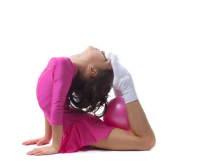 Flexible little girl doing gymnastic ring