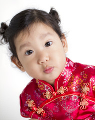 Cute child wearing red Chinese suit