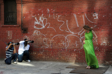 Two photographers shooting model