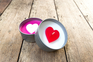 heart shaped candles on wooden