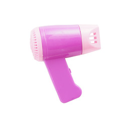 hair dryer - miniature plastic toy on white background