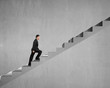 Businessman walking on stairs