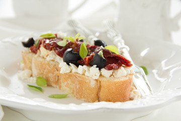Toast with feta cheese, sun-dried tomatoes.