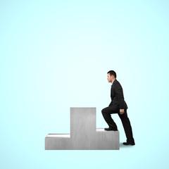 Businessman climbing on podium