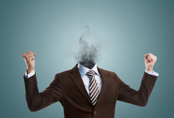 Overworked burnout business man standing headless with smoke ins