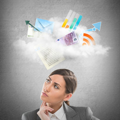 Businesswoman looking using cloud technologies to store her data