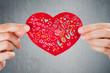 Sharing love. Valentine's day background. Closeup of female hand