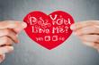 Do you love me? Valentine's day background. Closeup of female ha