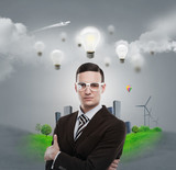 Ecology ideas concept. Businessman standing in front of cityscap
