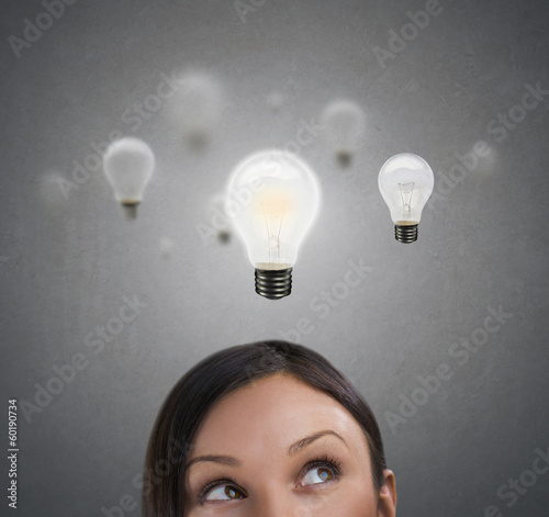Woman with lamps overhead, idea concept