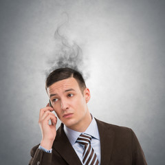 Concept of stress with businessman calling by phone