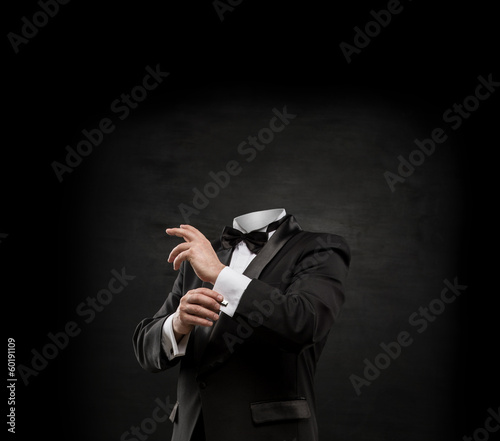 Man without head on dark concrete background