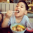 boy enjoy eating shells with rice japanese food