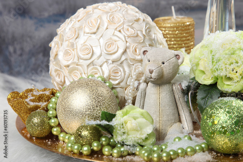 Christmas composition with balls and teddybear in golden tones