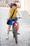 Urban biking - teenage boy and bike in city