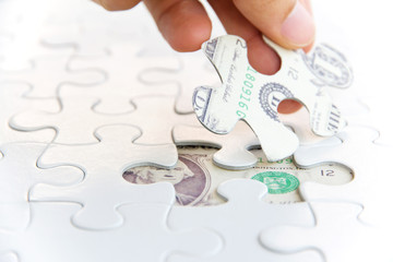 hand holding a puzzle piece, Finance concept