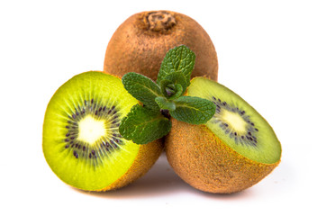 sliced kiwi with mint on white background