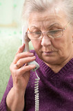 Mature woman age 70-75 years speaking on the phone.