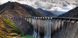 dam with overflow in autumn - 60195176