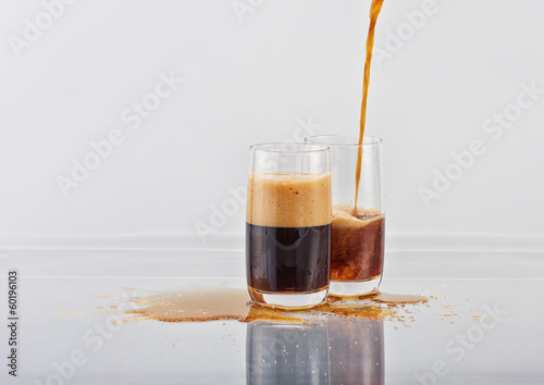 Two glasses with the aerated dark drink