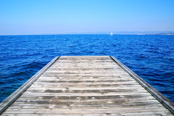 small wooden pier over the sea