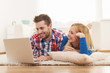 Happy couple surfing the net at home