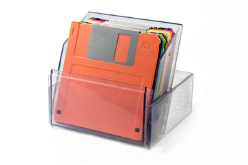 Colored diskettes in a transparent box.
