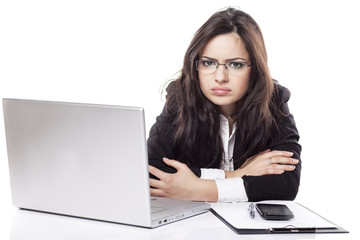 nervous and sad young business woman at the desk with a laptop
