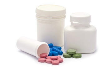 Pink, Blue and Green Drugs with Containers isolated on white