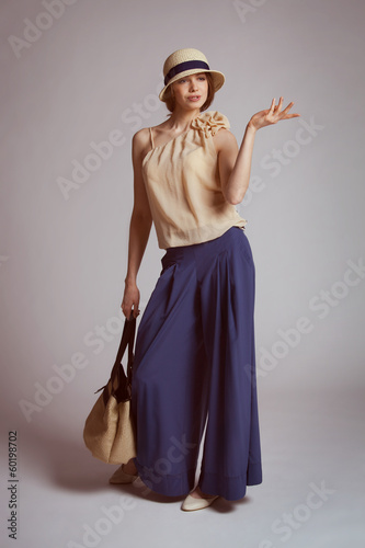 Stylish woman in retro suit with a bag