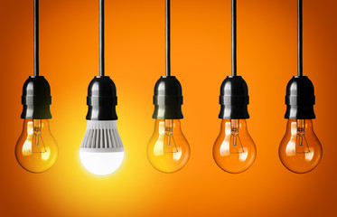 Eco concept with glowing LED bulb