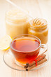 honey in jar and cup of healthy tea