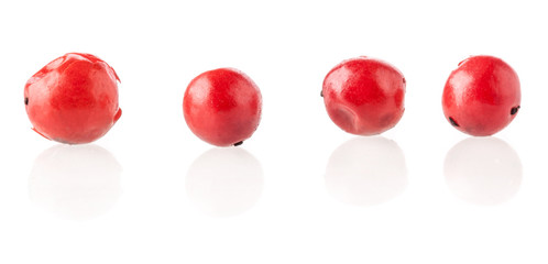 "Red peppercorn (""Brazil Pepper"") isolated on white"