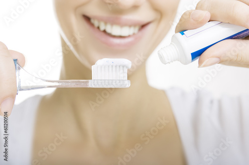 Closeup girl with toothbrush cleaning teeth at home, whiten toot